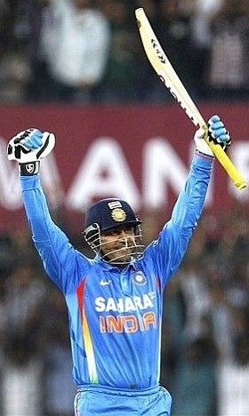 Sehwag scoring his century during his double century knock.